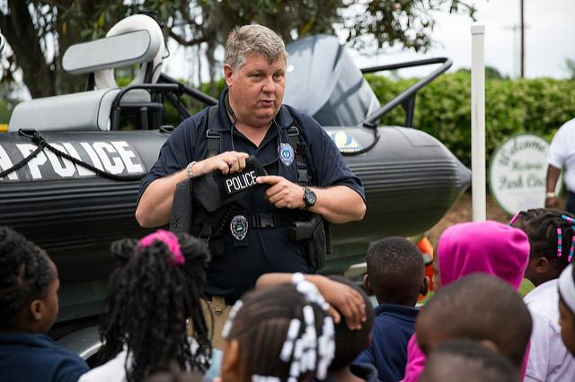 A public safety officer participates in a safety demonstration with schoolchildren in Charleston, South Carolina. (Flickr/South Charleston)