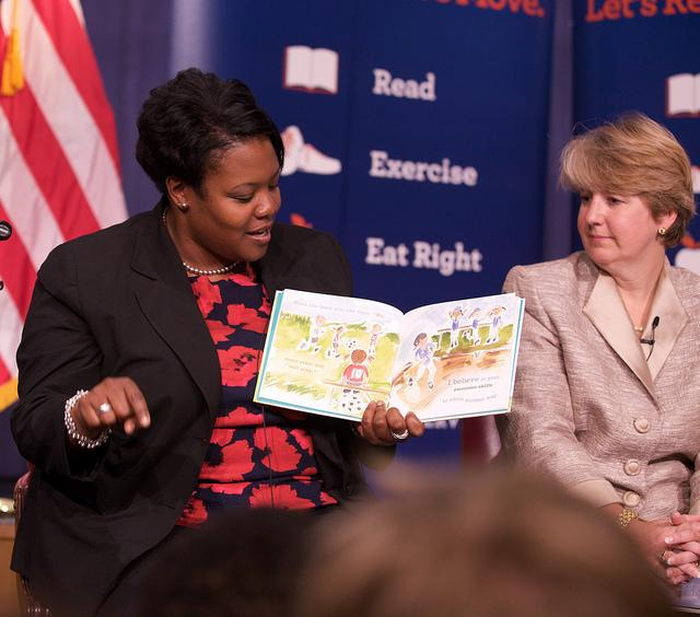 DC Public Schools Chancellor Kaya Henderson -- pictured here reading to students at a U.S. Department of Education event -- announced Wednesday the district will be investing $20 million in support programs and a new school for black and Latino male students. Source: Flickr/ U.S. Department of Education (CC BY 2.0)